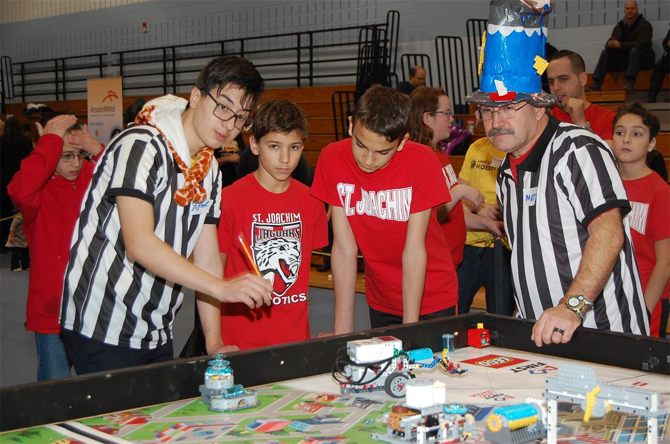 Referees review scores with members of the St. Joachim Jaguars at the FIRST LEGO League Hamilton Regional Qualifier on Dec. 9.