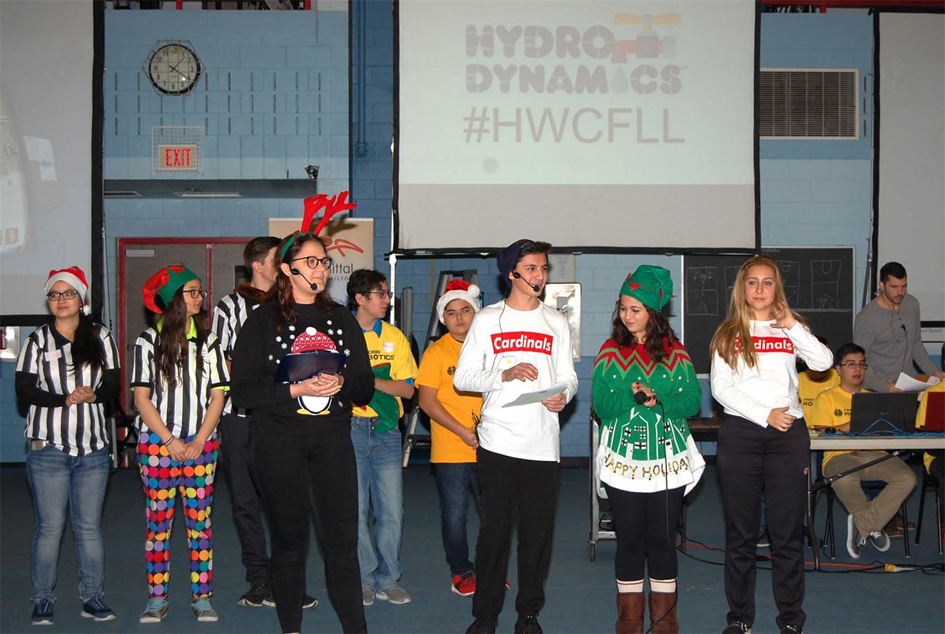 FIRST LEGO League also provides leadership opportunities for secondary students, who organize and plan the event. Serving as Masters of Ceremony at the Hamilton Qualifier were, from left to right, Dalia Dudalski (St. Thomas More), Matt Sbrissa (Cardinal Newman), Juliana Giannini (Cardinal Newman), and Anna Krzysztofinski (Cardinal Newman).