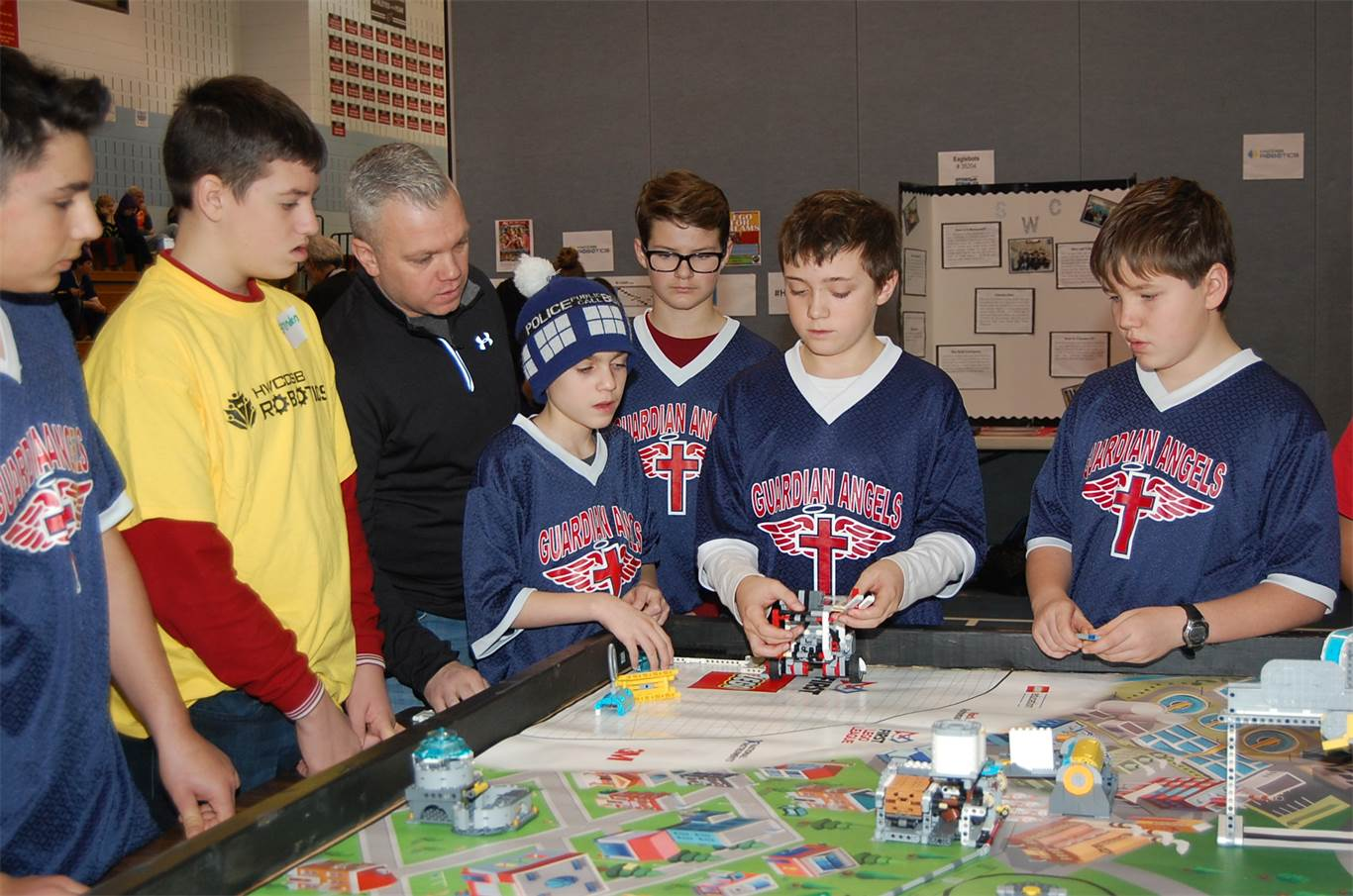 Members of the Guardian Angels robotics team play the